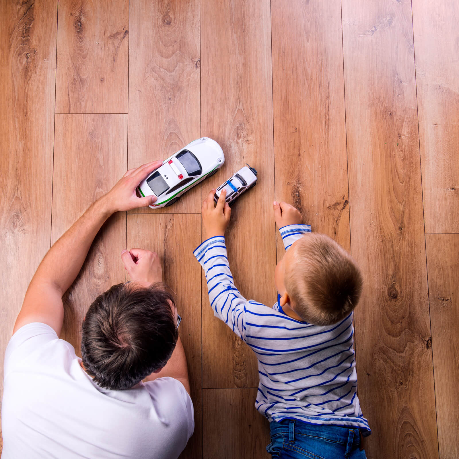 Father with kid playing with toycar | Boyle's Floor & Window Design